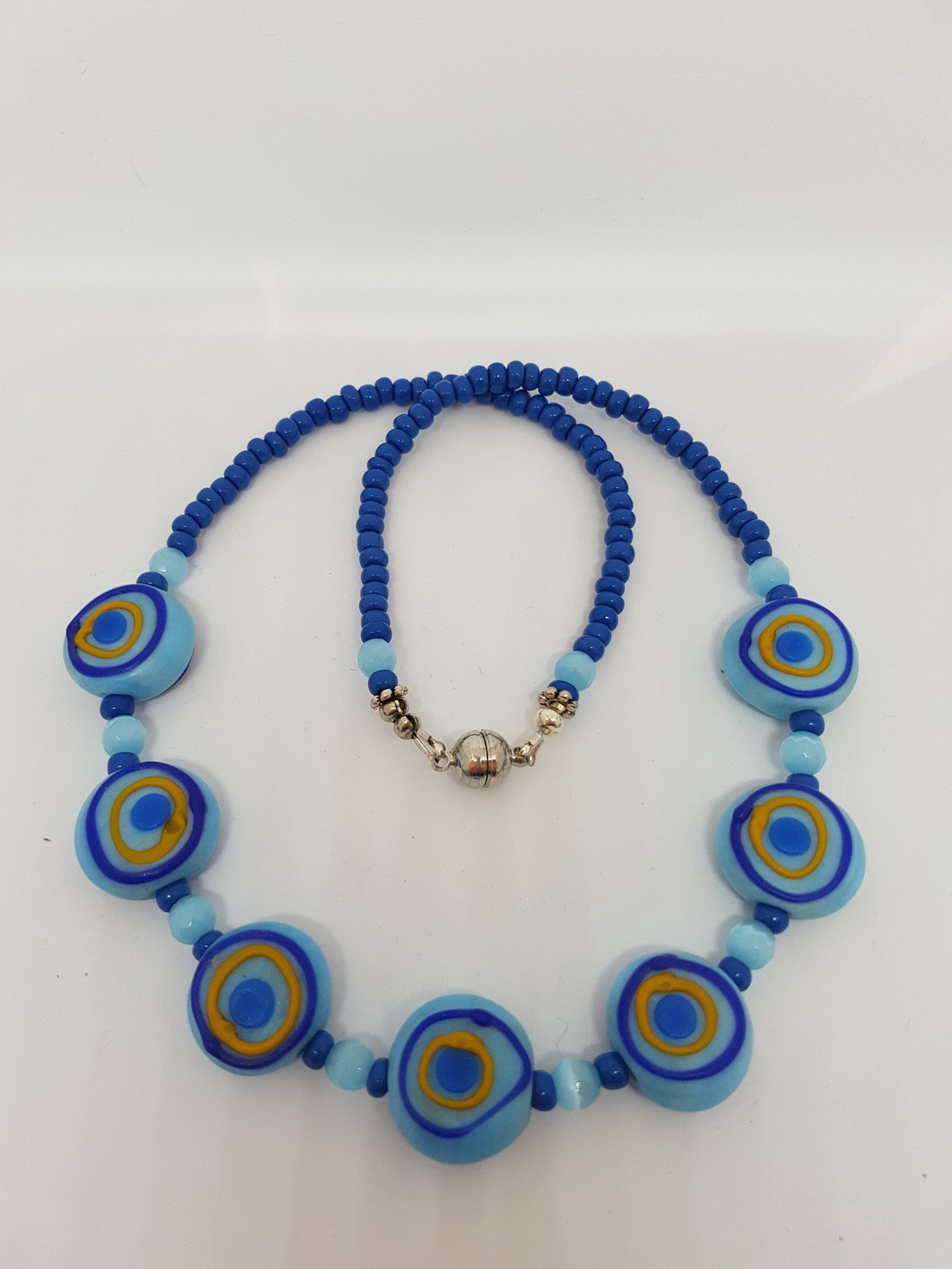Blue beaded necklace with 7 focal beads