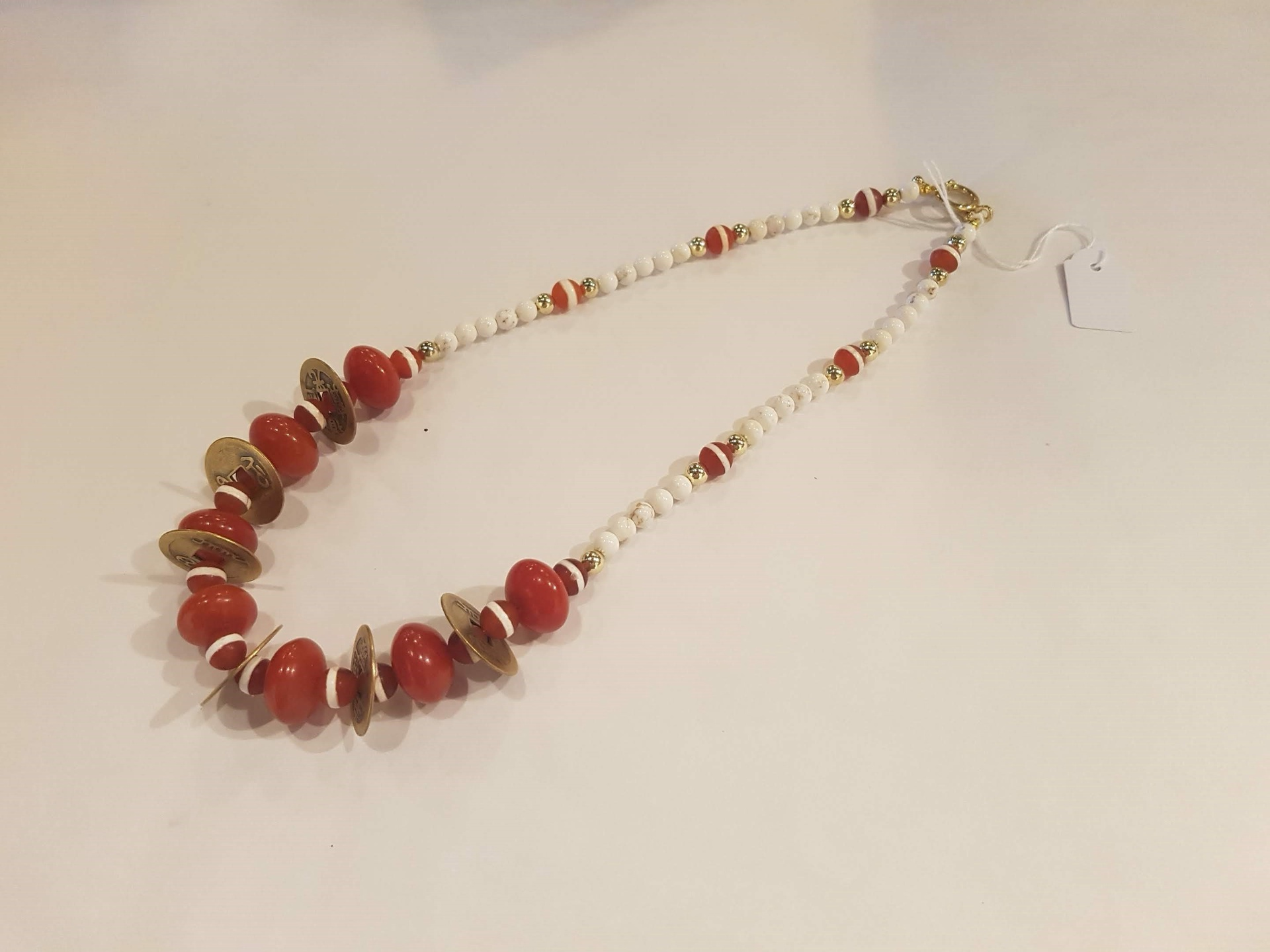 Resin, cream agate and gold tone coin necklace