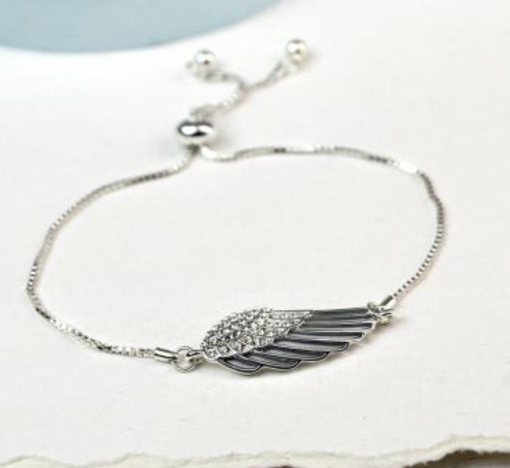 Silver plated enamel angel wing bracelet.