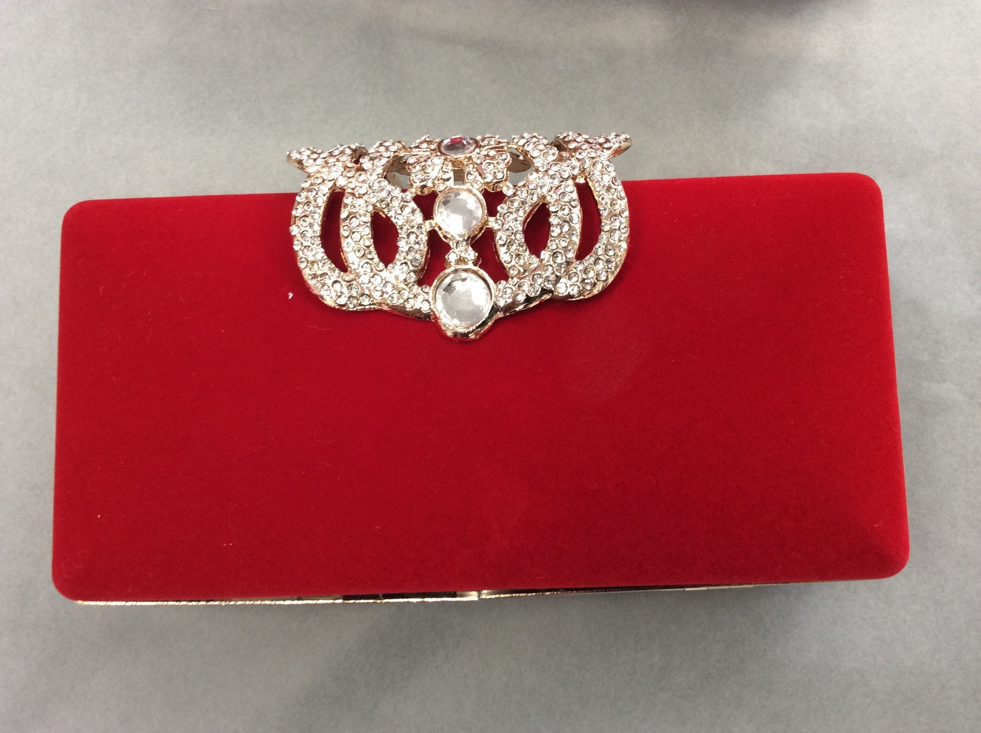 Red/gold clutch bag