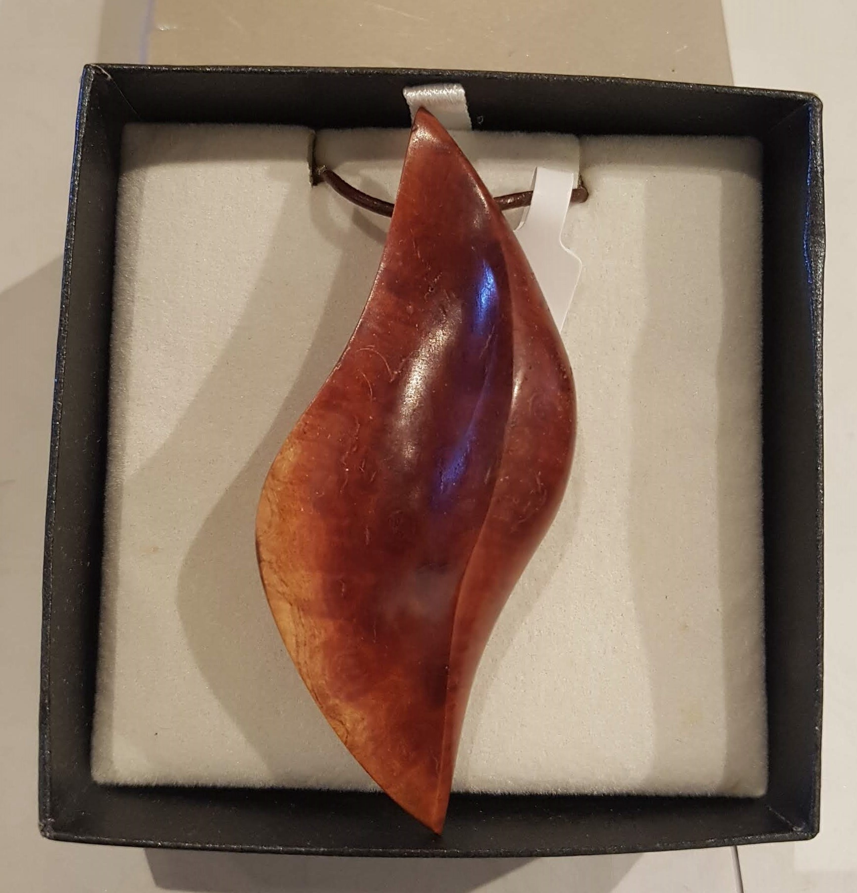Hand carved wooden pendant