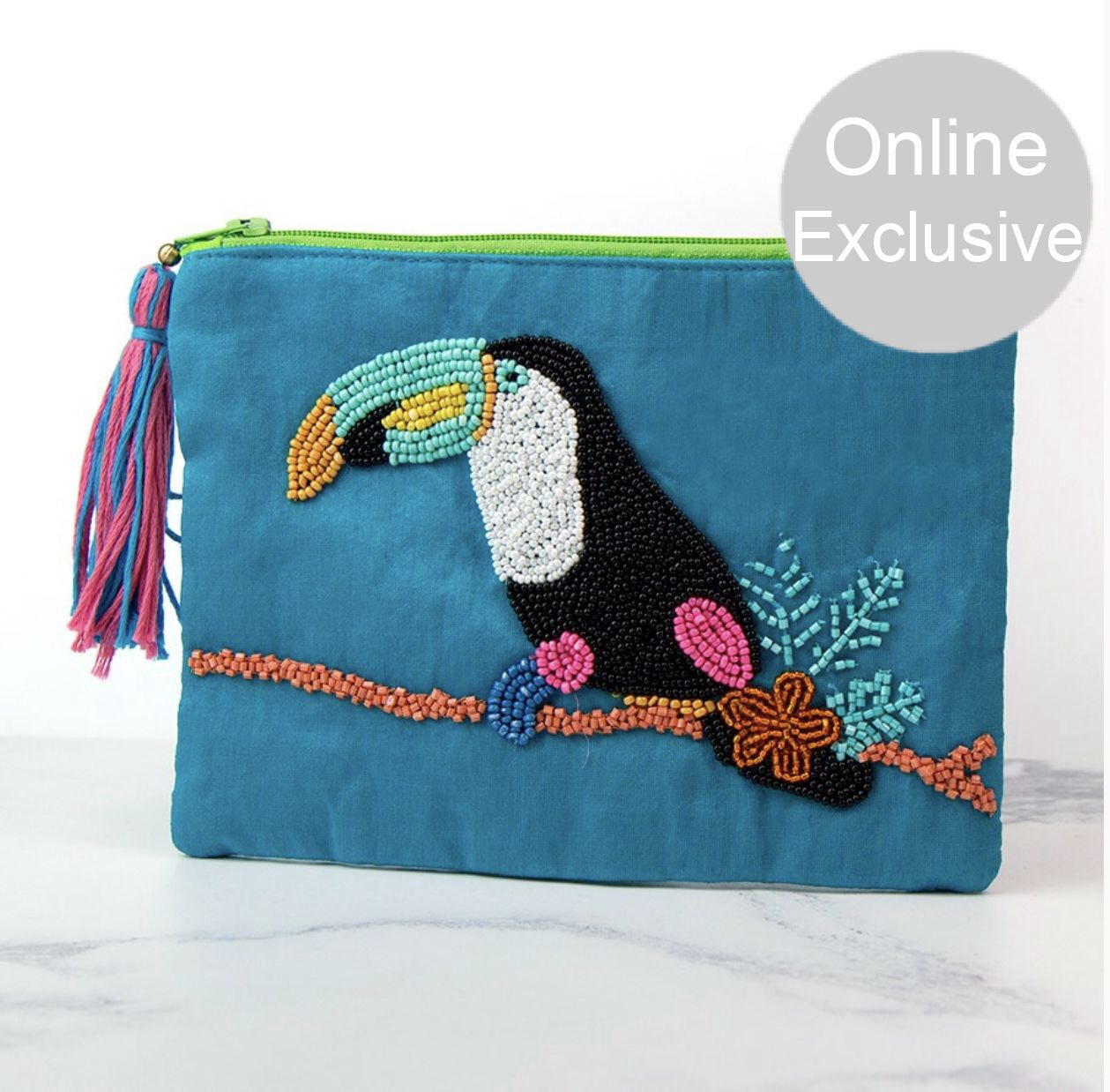 Turquoise embellished purse with hand sewn beaded toucan