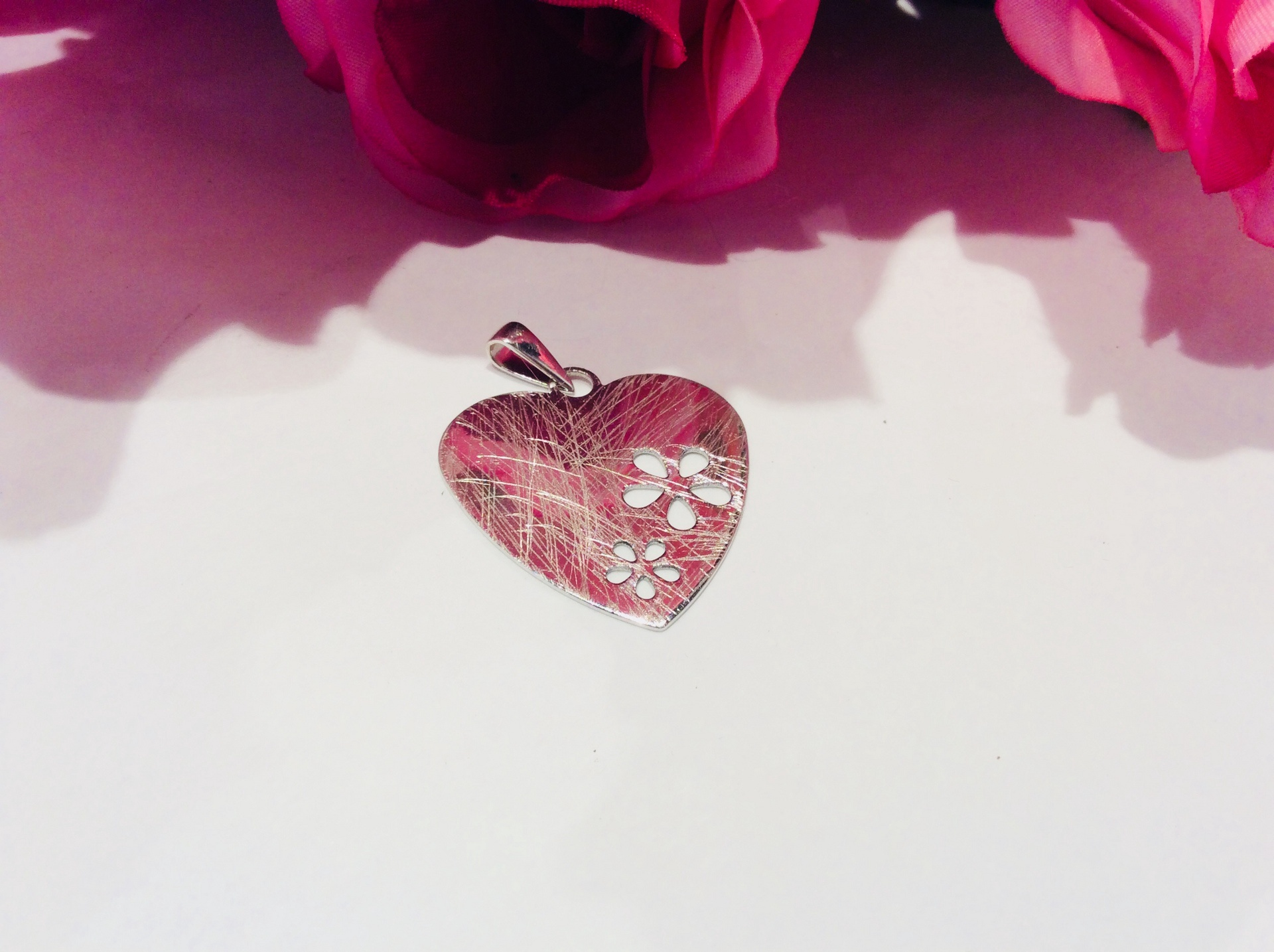 Sterling Silver Heart Pendant with flower cutouts