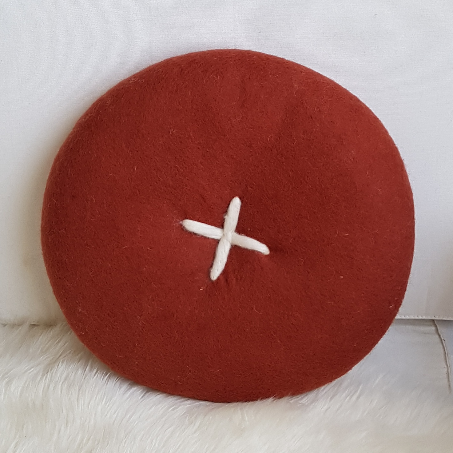 BUTTON CUSHION - RUST