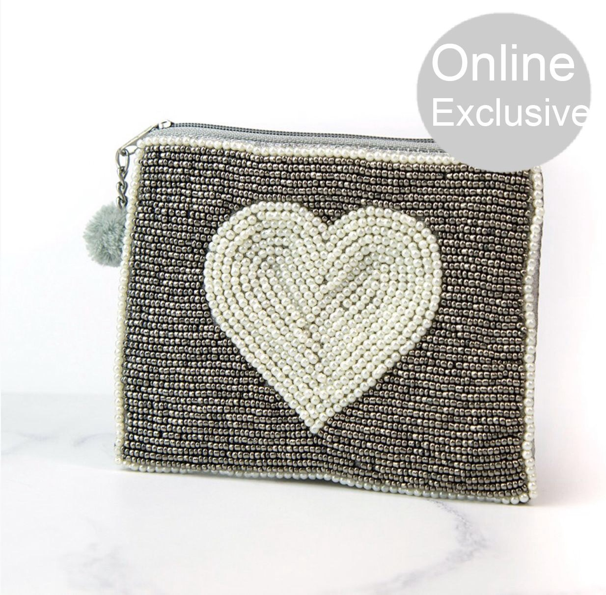 Metalic grey purse with pearl heart design with pom pom