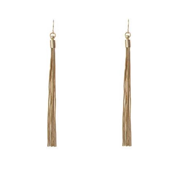 Worn gold tassel earrings