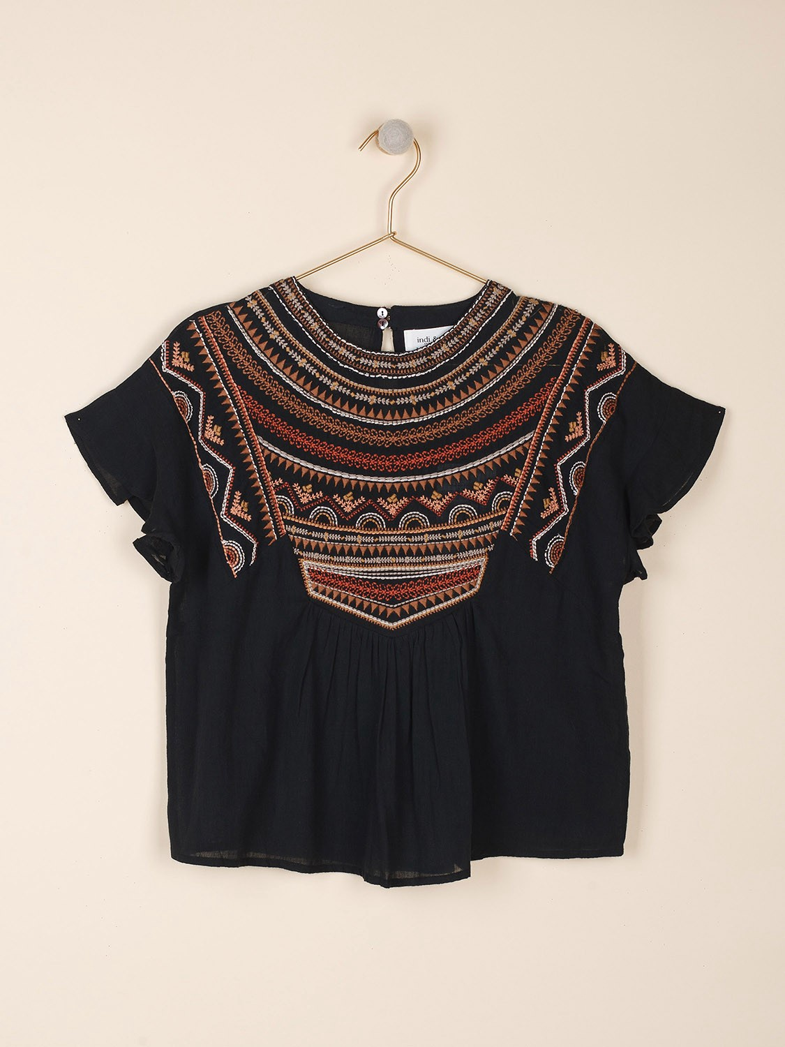 Top with folk embroidery