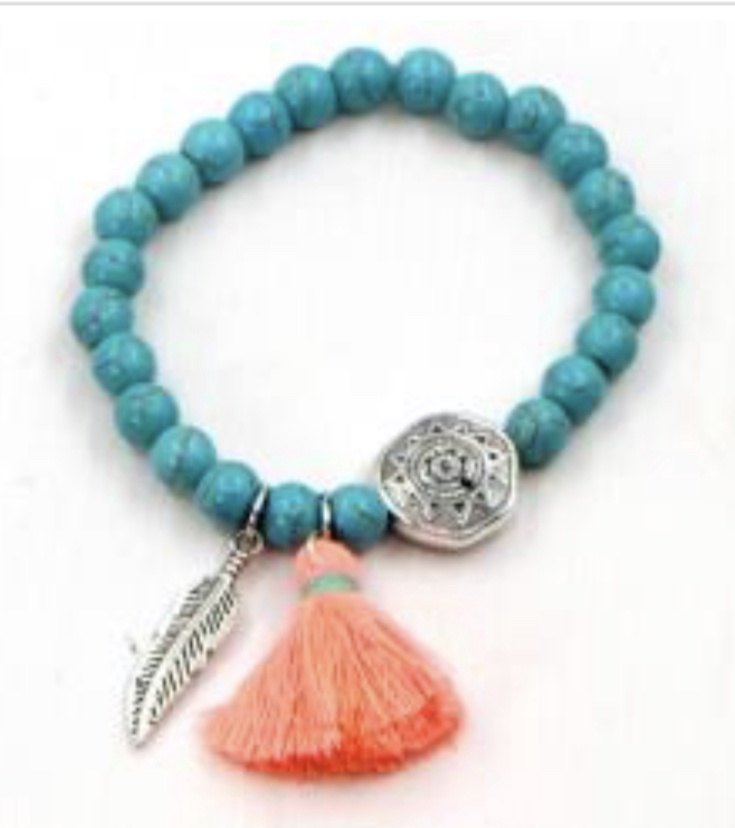 Turquoise bead elasticated bracelet with tassel and feather charm
