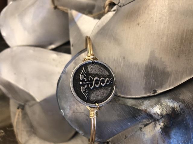 Registered Nurse on Brass