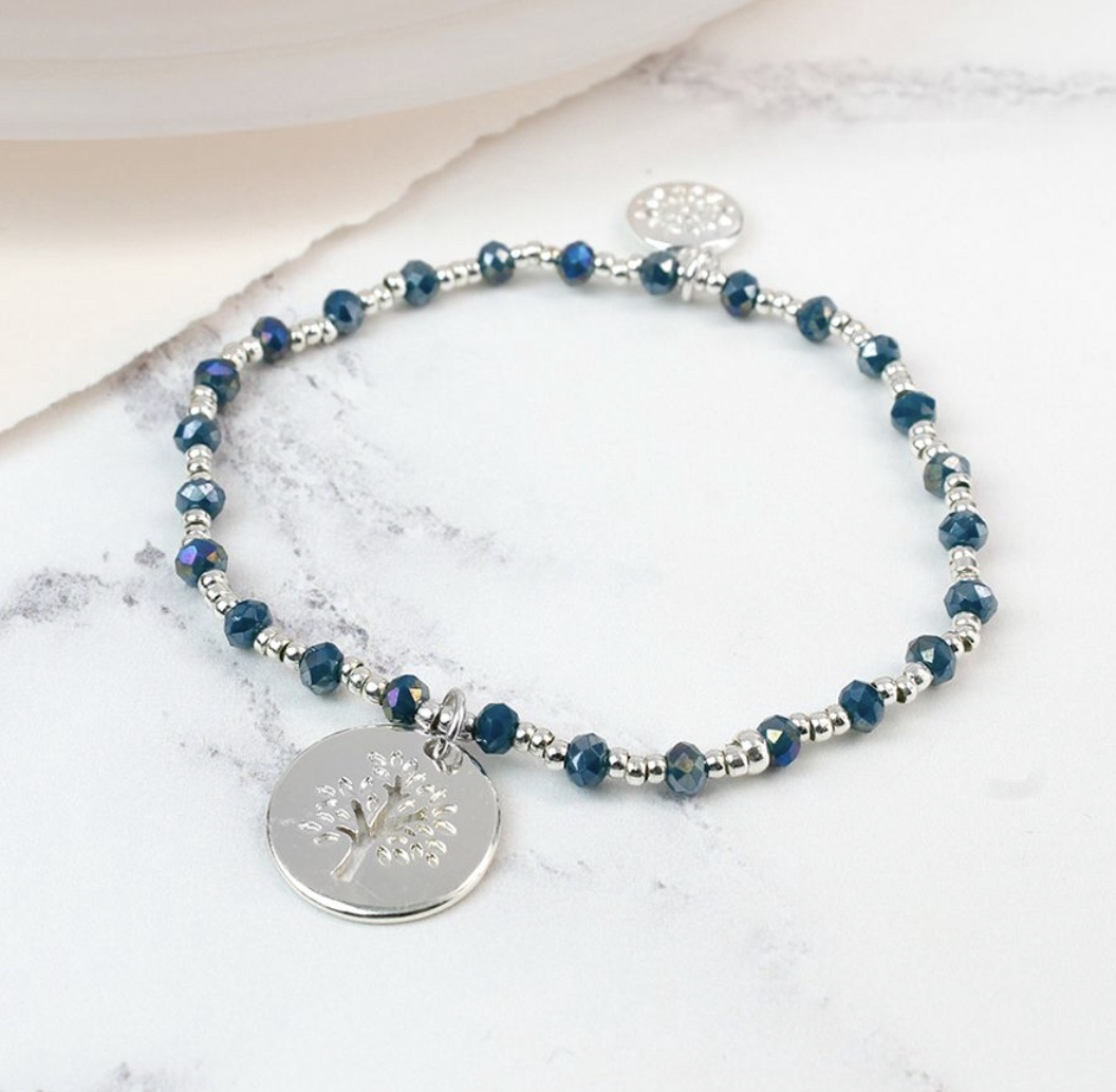 Silver plated bracelet with blue beads and tree charm