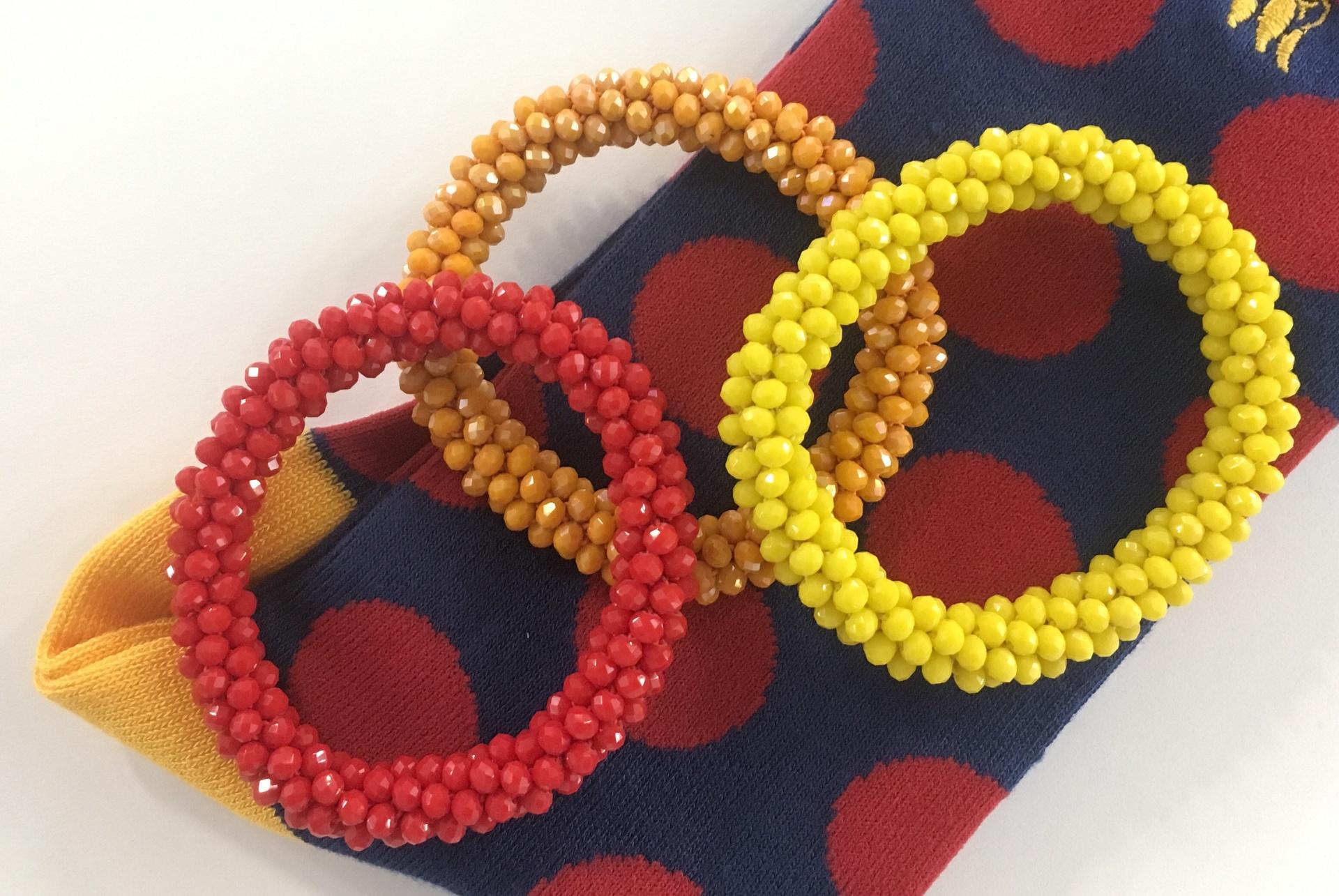 Orange beaded crochet bracelet