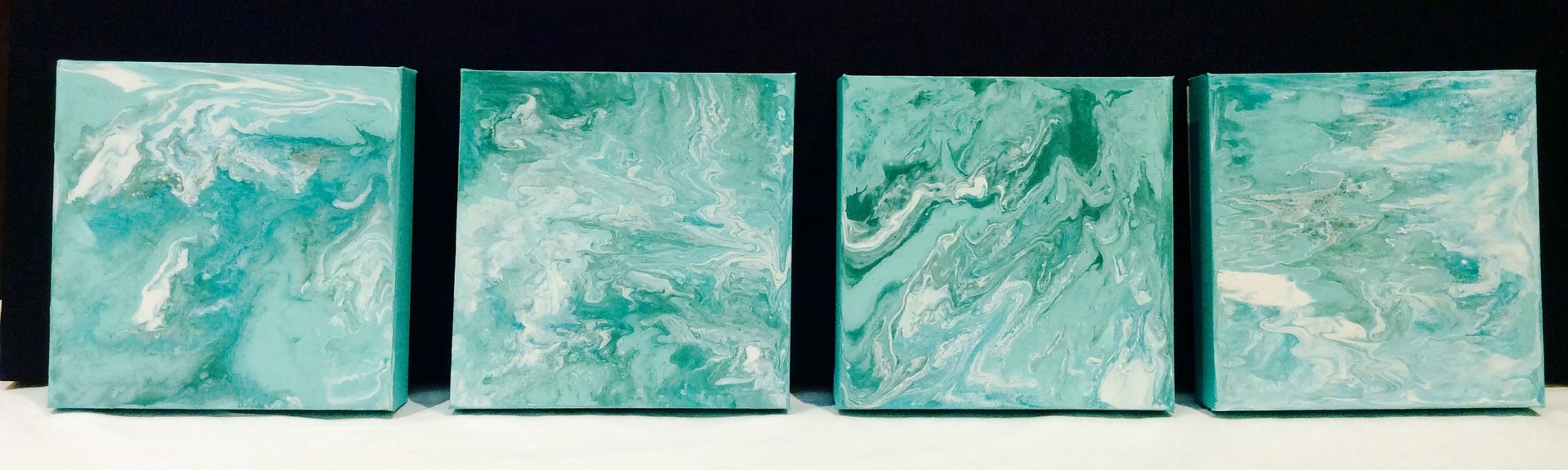 Set of four 'Sea Blue' paintings