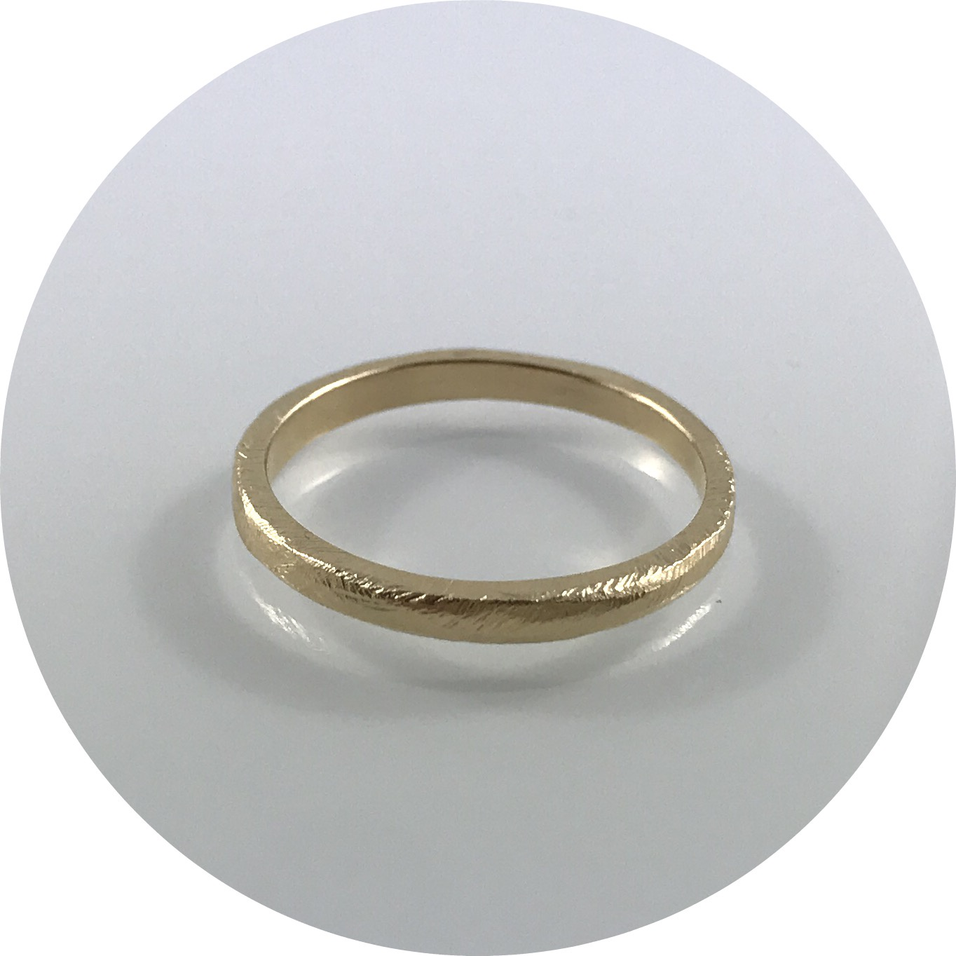 Ashleigh Moore - Fine organic stacking band in 9kt yellow gold