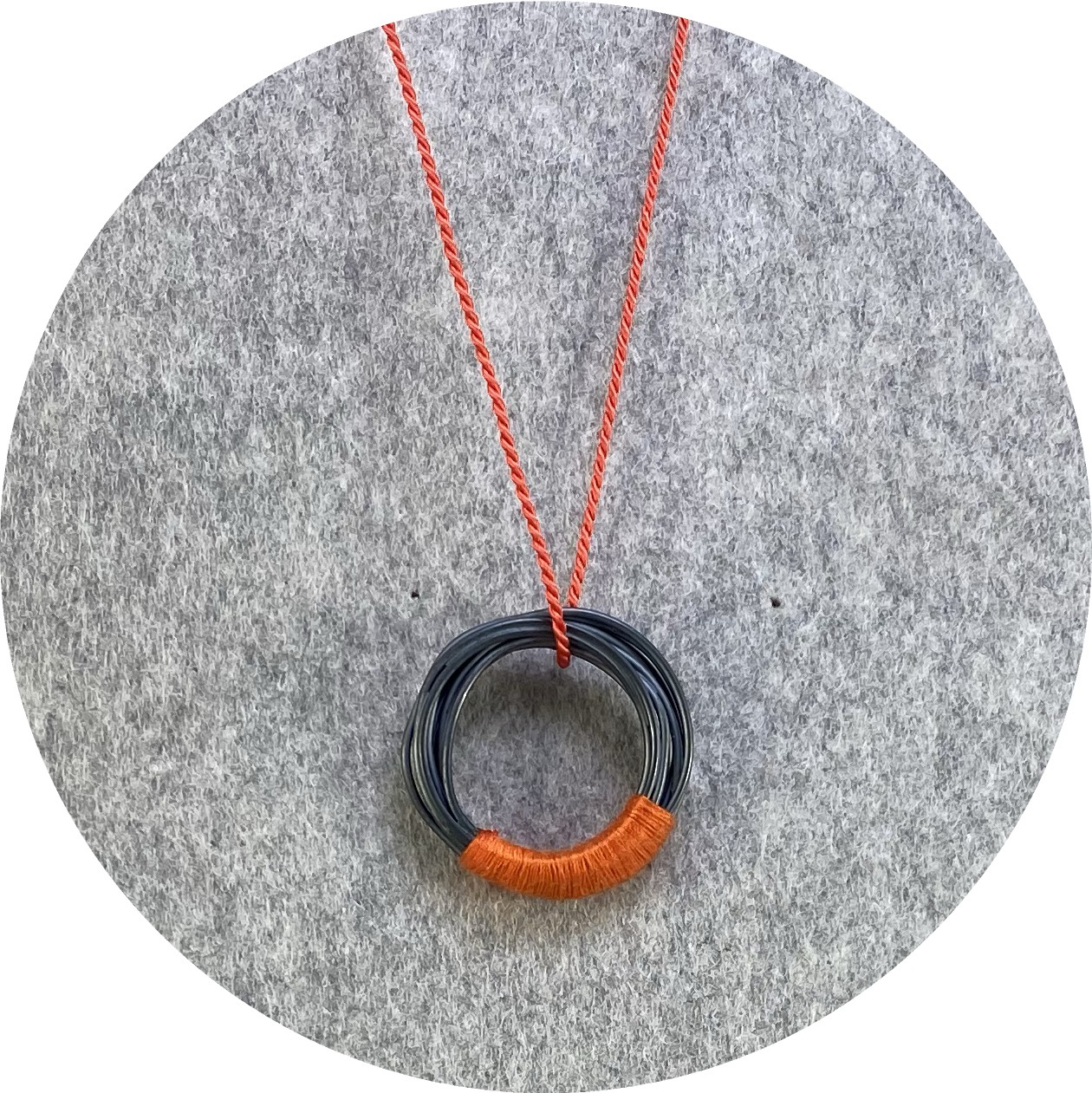 Melissa Gillespie - 'Oxidized Wrapped Coiled Pendant' in Sterling Silver on a Orange Silk Cord