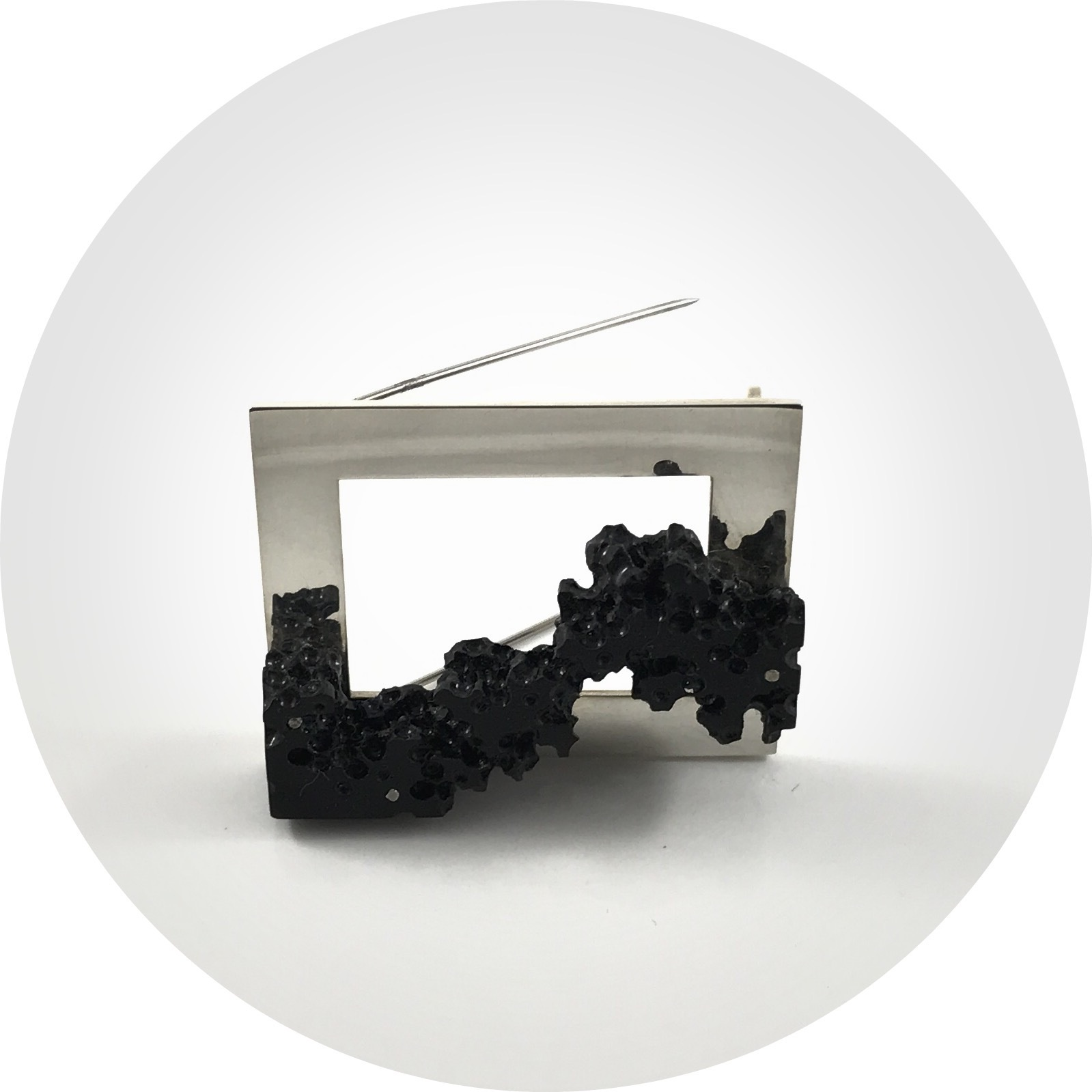 Carly Lay– weathered honeycomb erosion #2.Ebony brooch. sterling  silver, ebony, varnish and linseed oil.