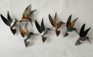 Hummingbirds flock metal wall art
