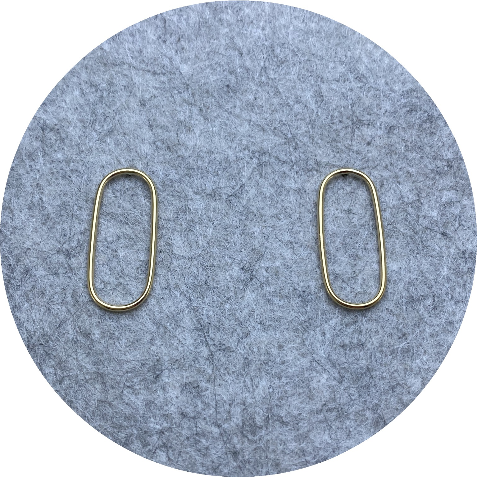 KIN- 9ct yellow gold oval wire studs.