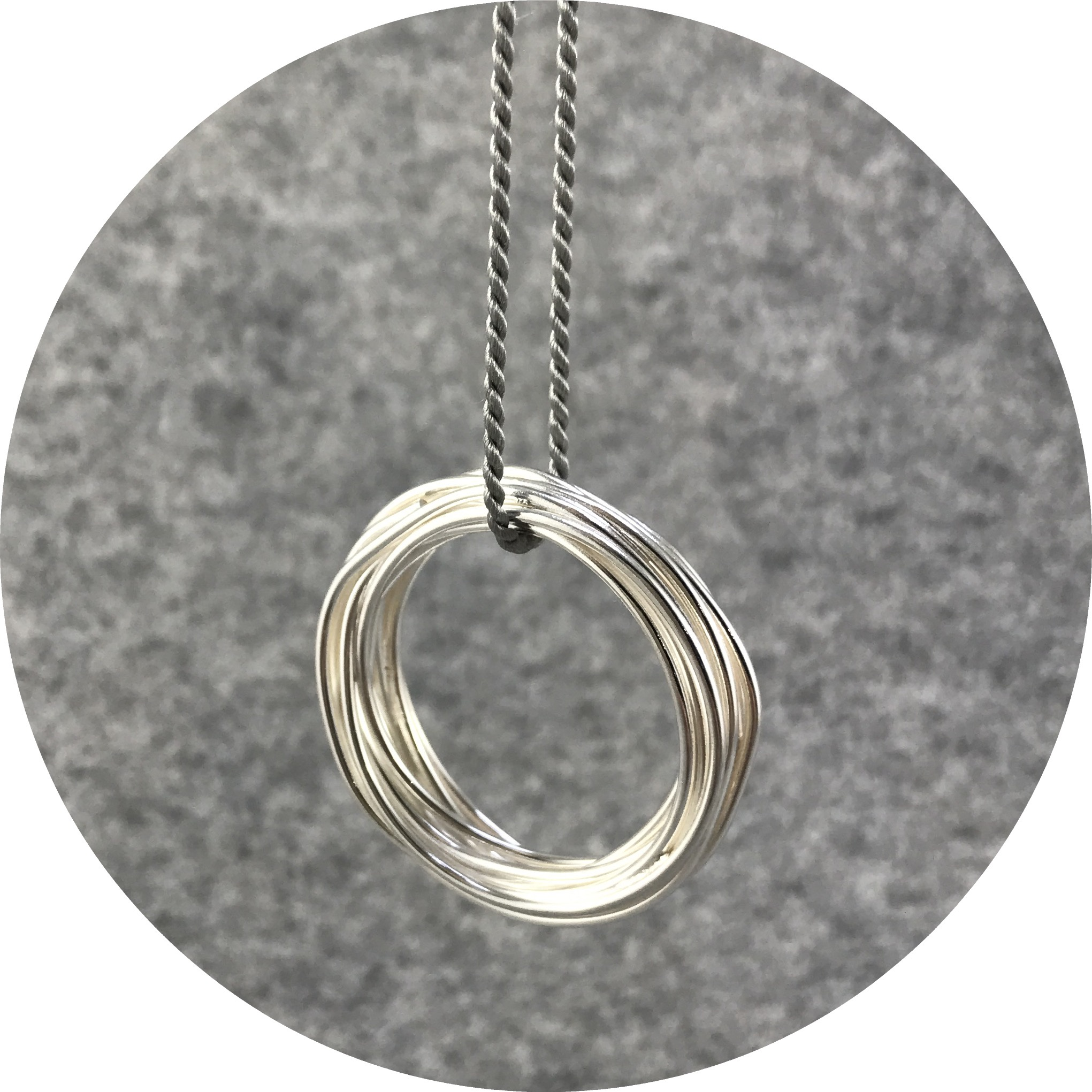 Melissa Gillespie - 'Continuous Circle Pendant on Grey Cord', sterling silver, silk cord