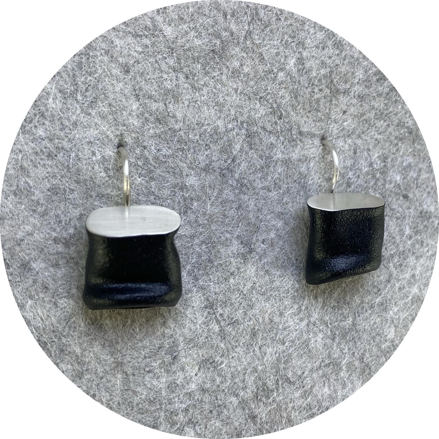 Robyn Clarke- Crushed matte black hook earrings. Copper and sterling silver.