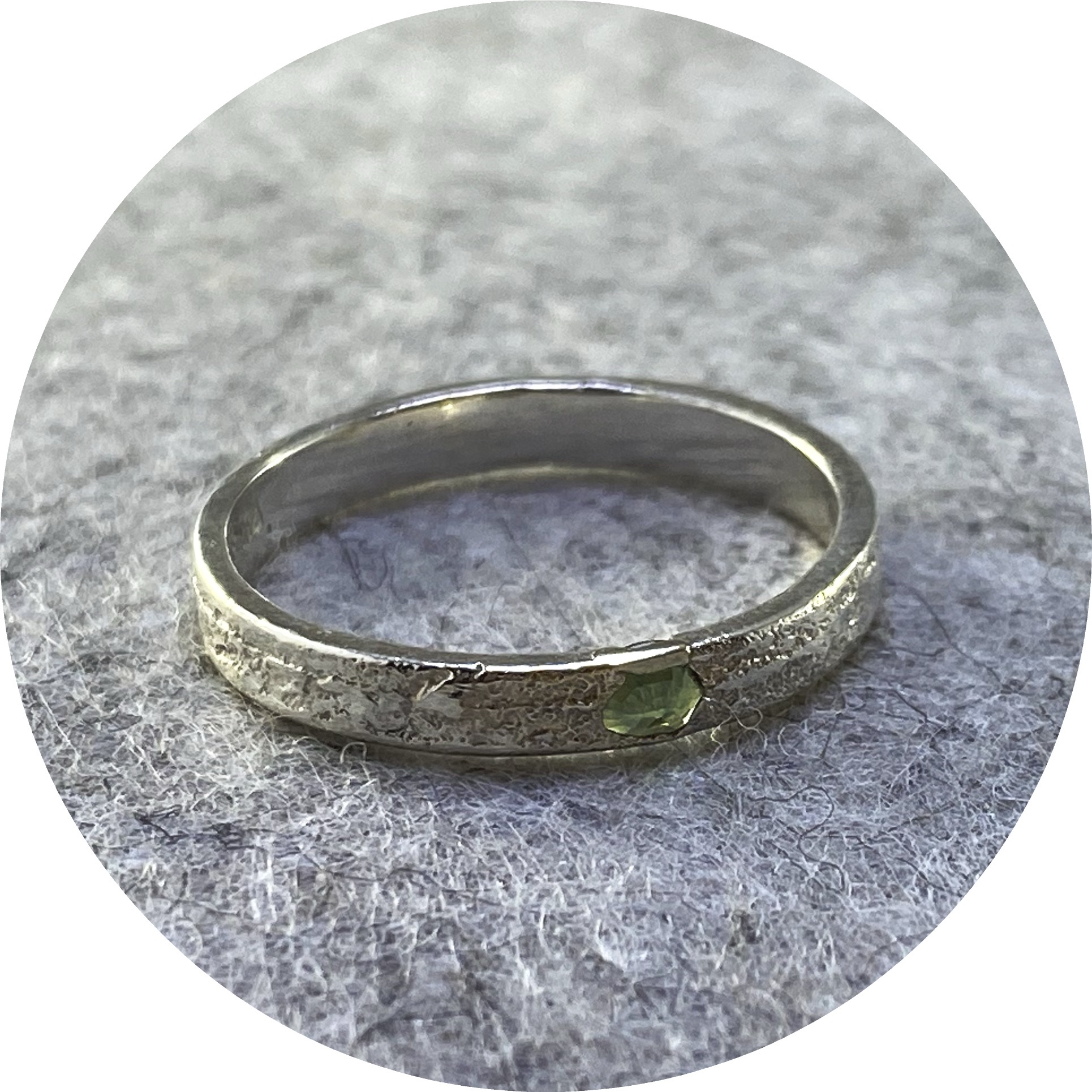 Kirra-Lea Caynes- Green sapphire cast in place ring in sterling silver.  size  Q
