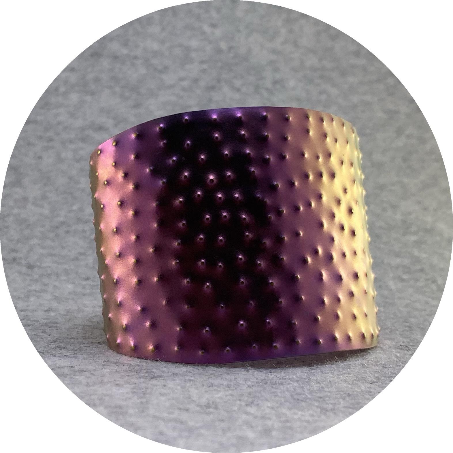 Amanda Croatto- Cuff. Pink and gold textured anodised titanium. 5cm wide