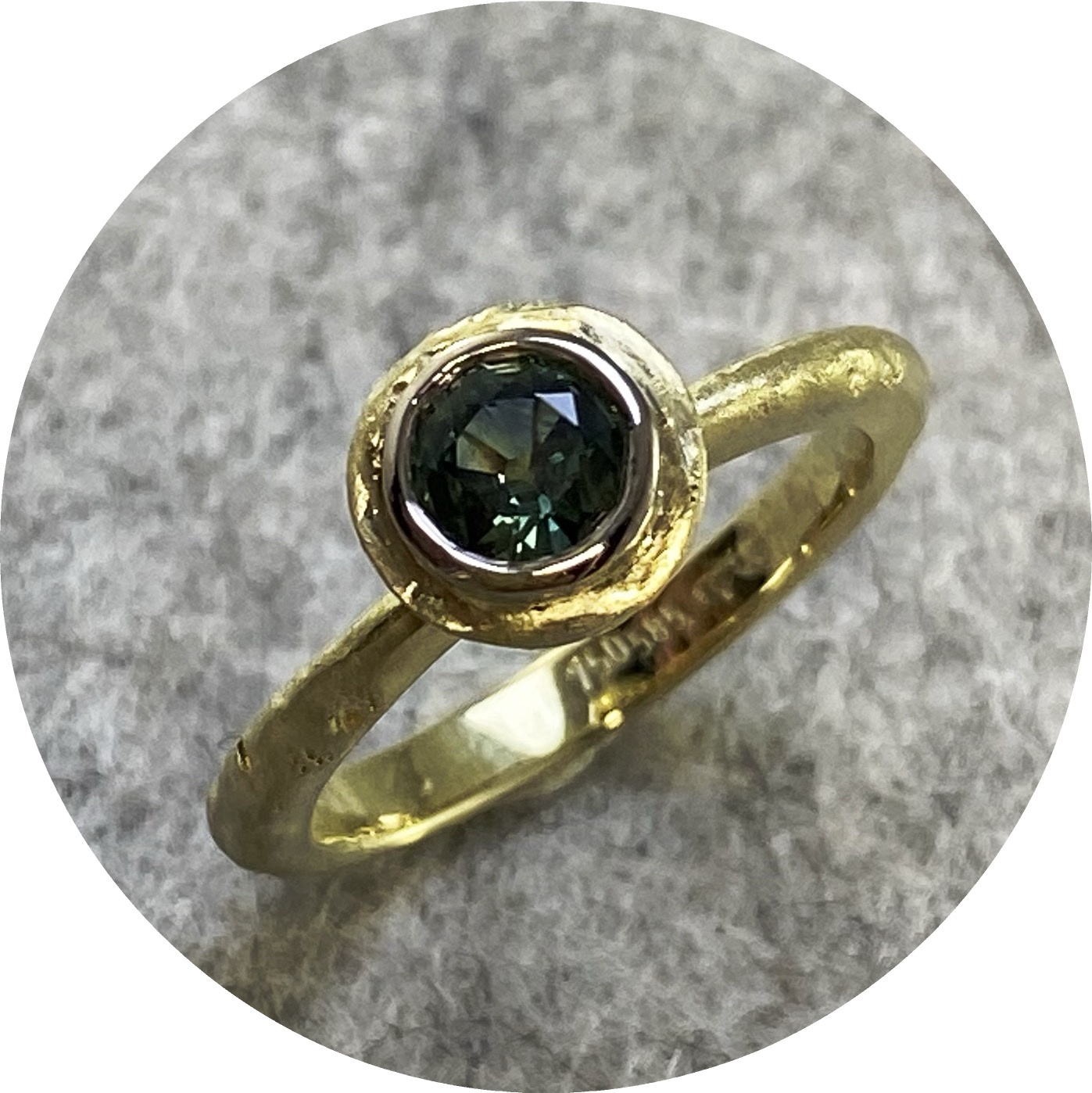Angela Natalier- Disarmed Solitaire. Inclined Halo, size M. 14ct yellow gold. 0.50ct Parti Australian sapphire mined and cut. 8x 1.5mm parti sapphires.