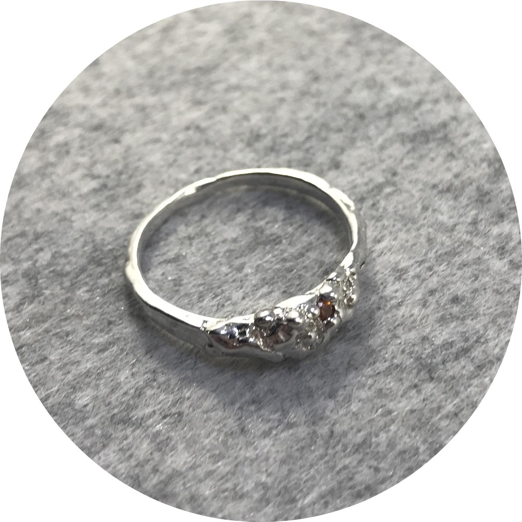 Lizzie Slattery- Organic Trilogy ring. Sterling silver and Orange Garnet. size Q.