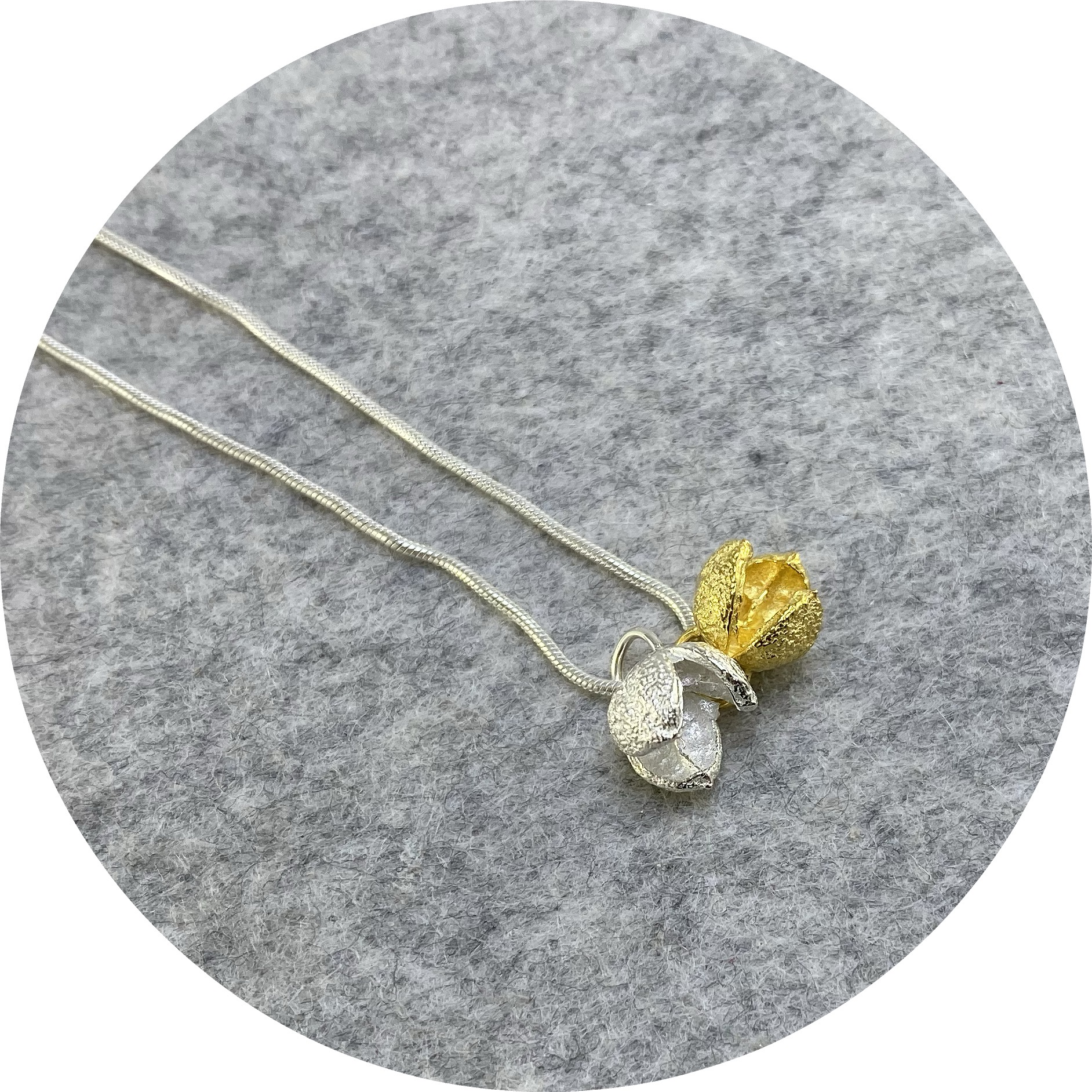 Manuela Igreja- Pittosporum charm necklace. Sterling silver and yellow gold plated.