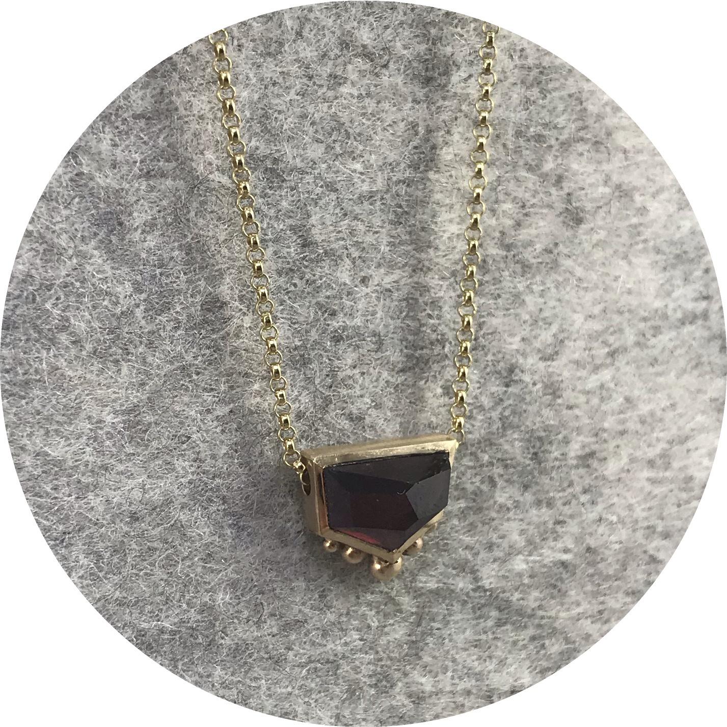 Katie Shanahan - 9ct Yellow Gold and Garnet pendant