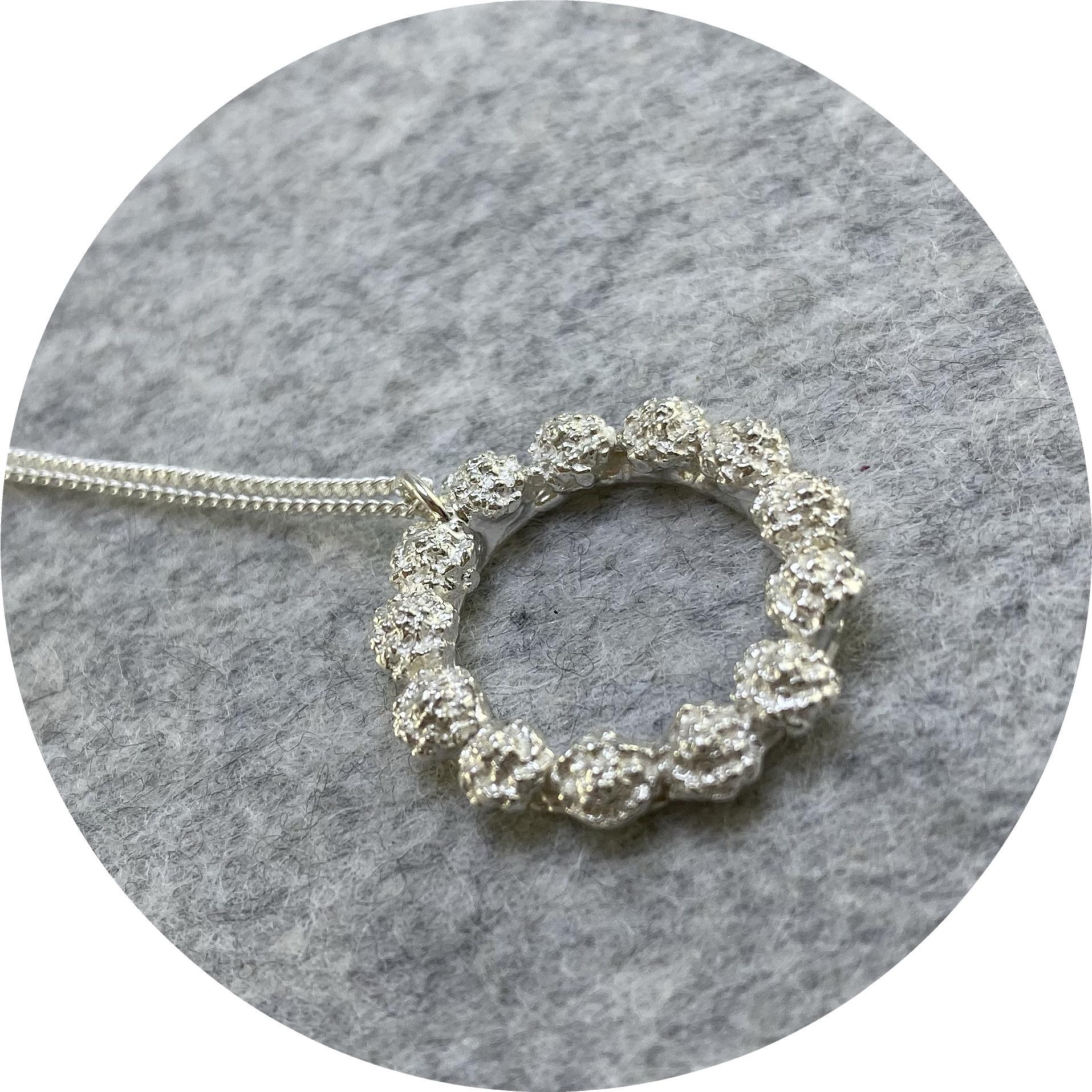 Manuela Igreja- Cushion Bush wreath pendant. Sterling silver.