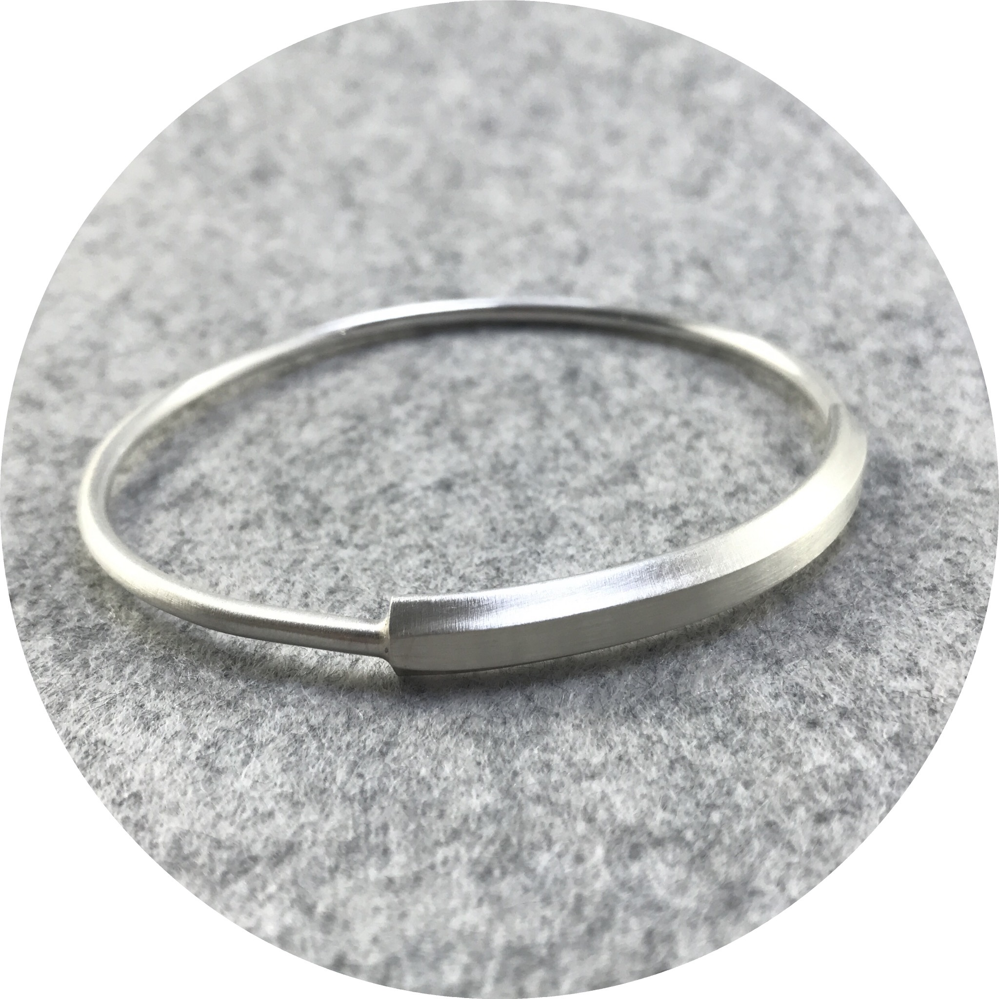 Rengin Guner- Sterling silver bangle with angled plate detail.