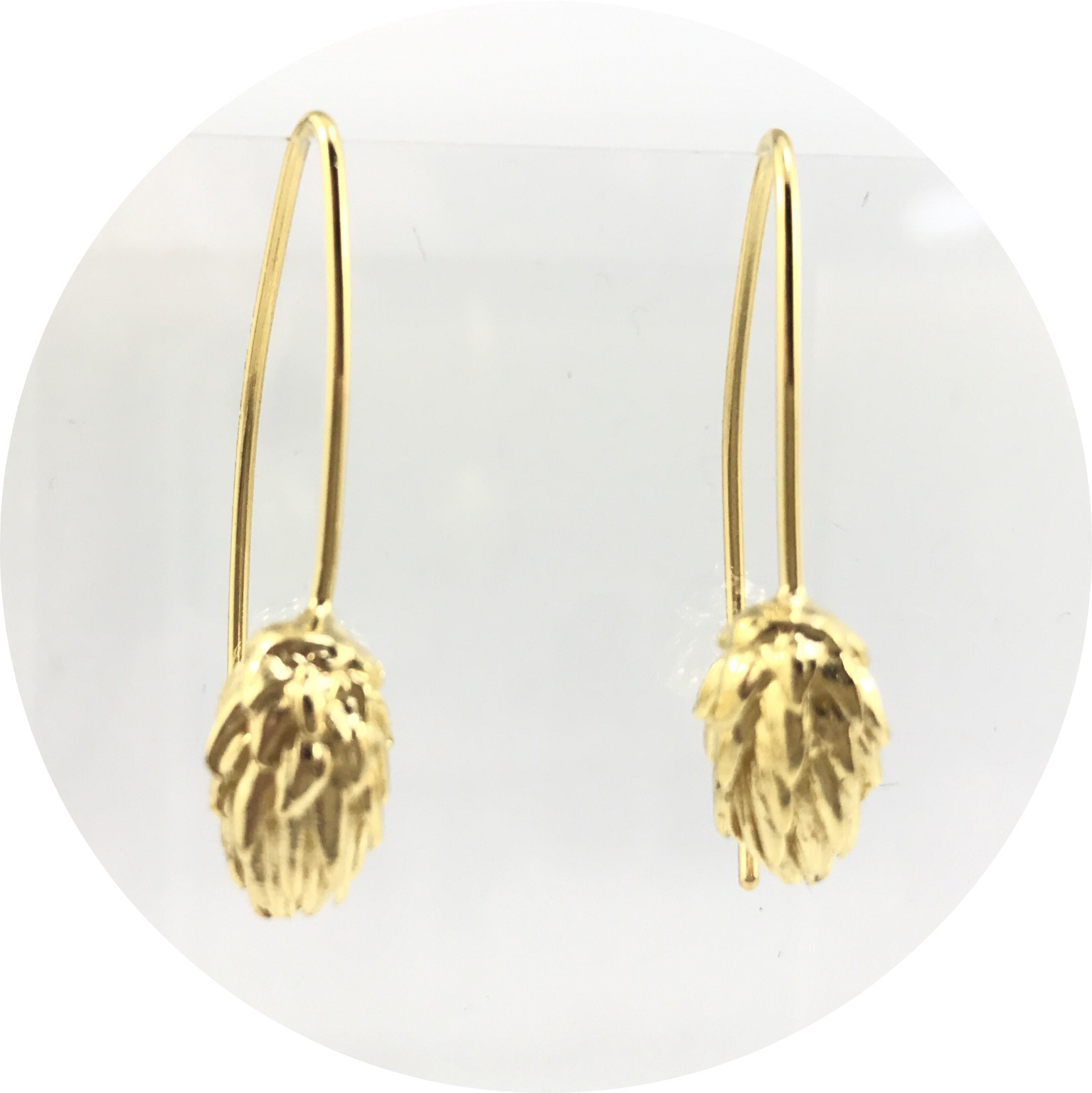 Manuela Igreja- pine sprout hook earrings. yellow gold plated sterling silver.