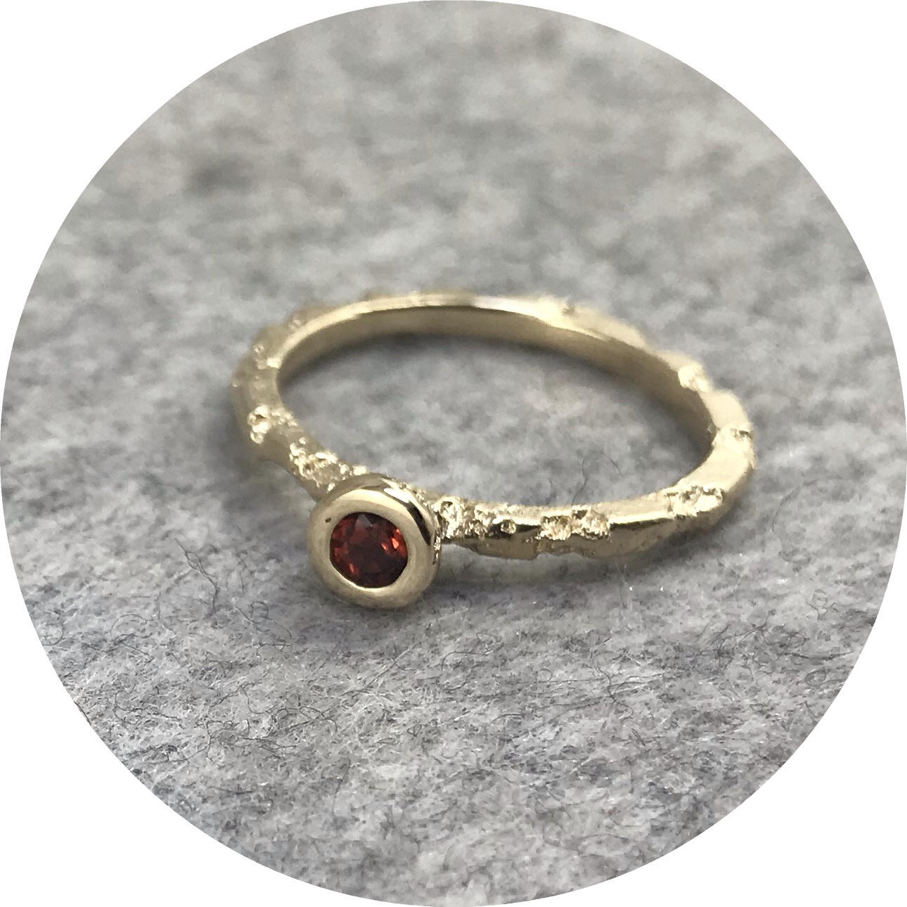 Albert Tse - Crater 1.5mm 9ct Yellow Gold Ring with a 3mm Red Garnet