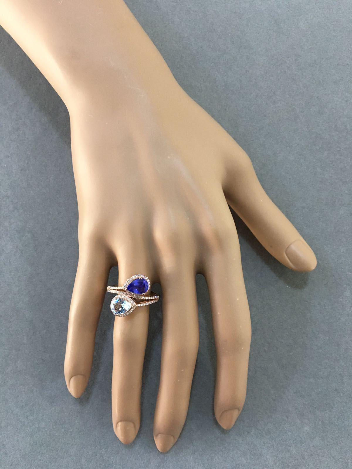 Two-Stone Pear Shaped Aquamarine, Tanzanite & Diamond Ring