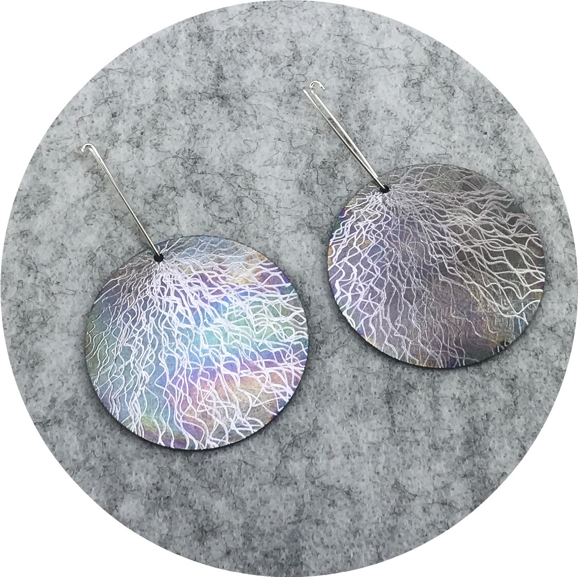 Tanja Von Behrens - Large Drop Circle Lighting Storm Earrings in Sterling Silver and Heat Coloured Titanium.