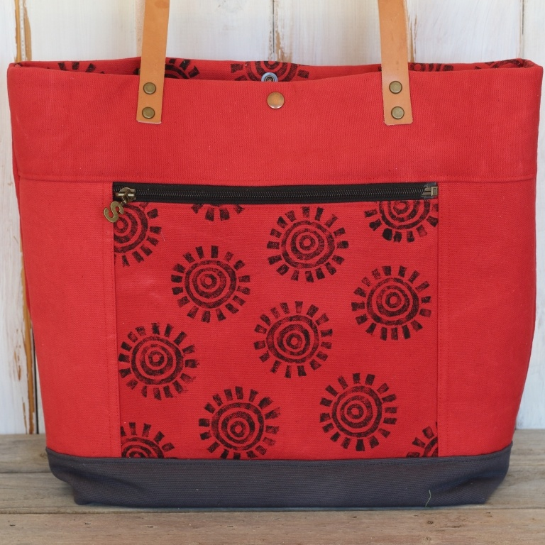 Red canvas tote with zippered pocket