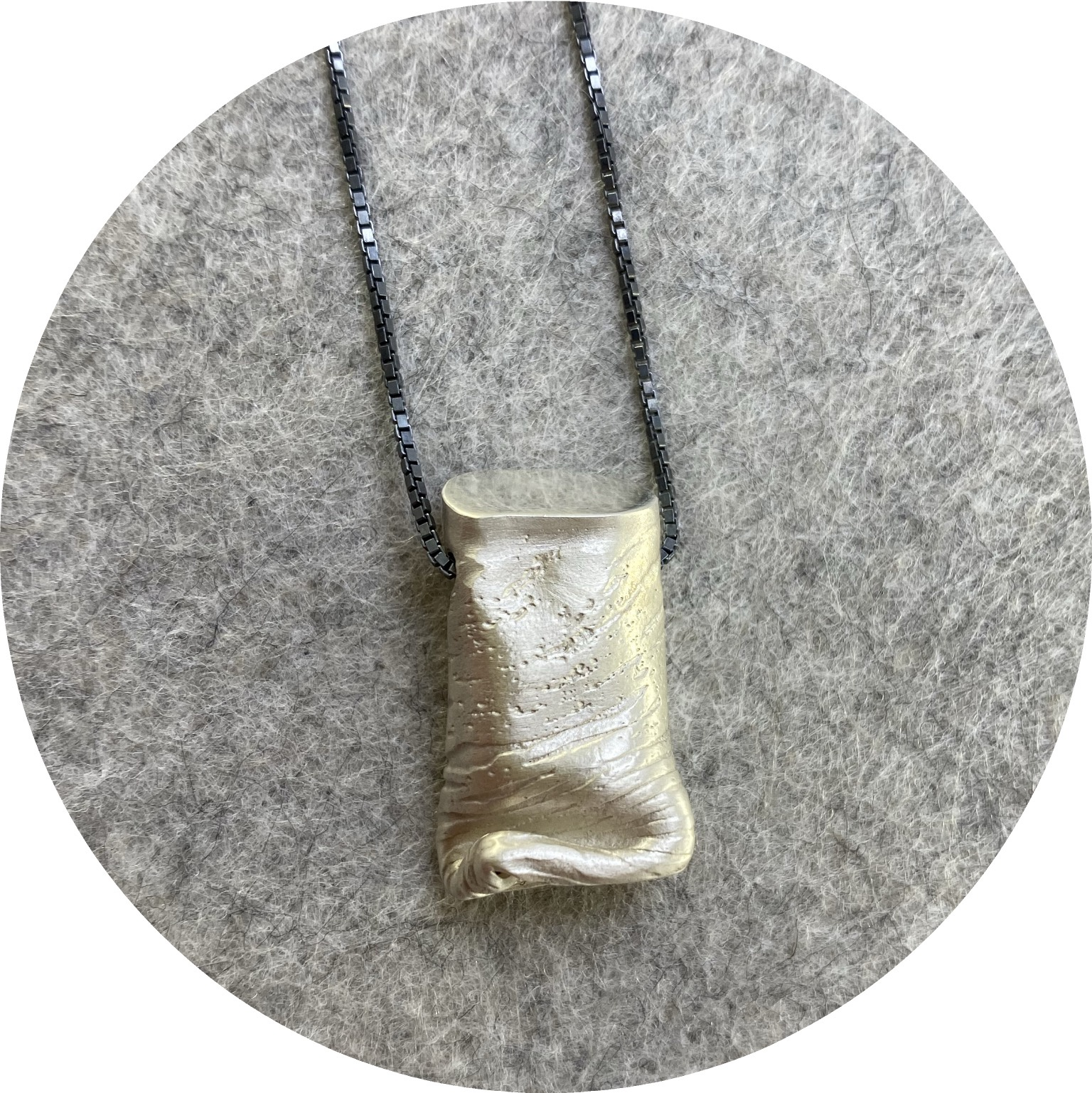 Robyn Clarke- Crushed pendant, etched. Sterling silver pendant and chain.