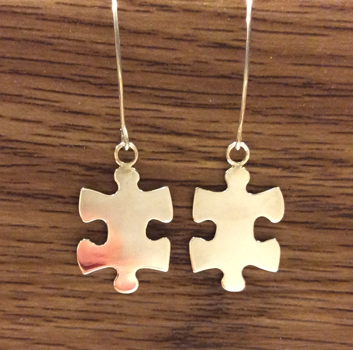Puzzle piece sterling silver earrings