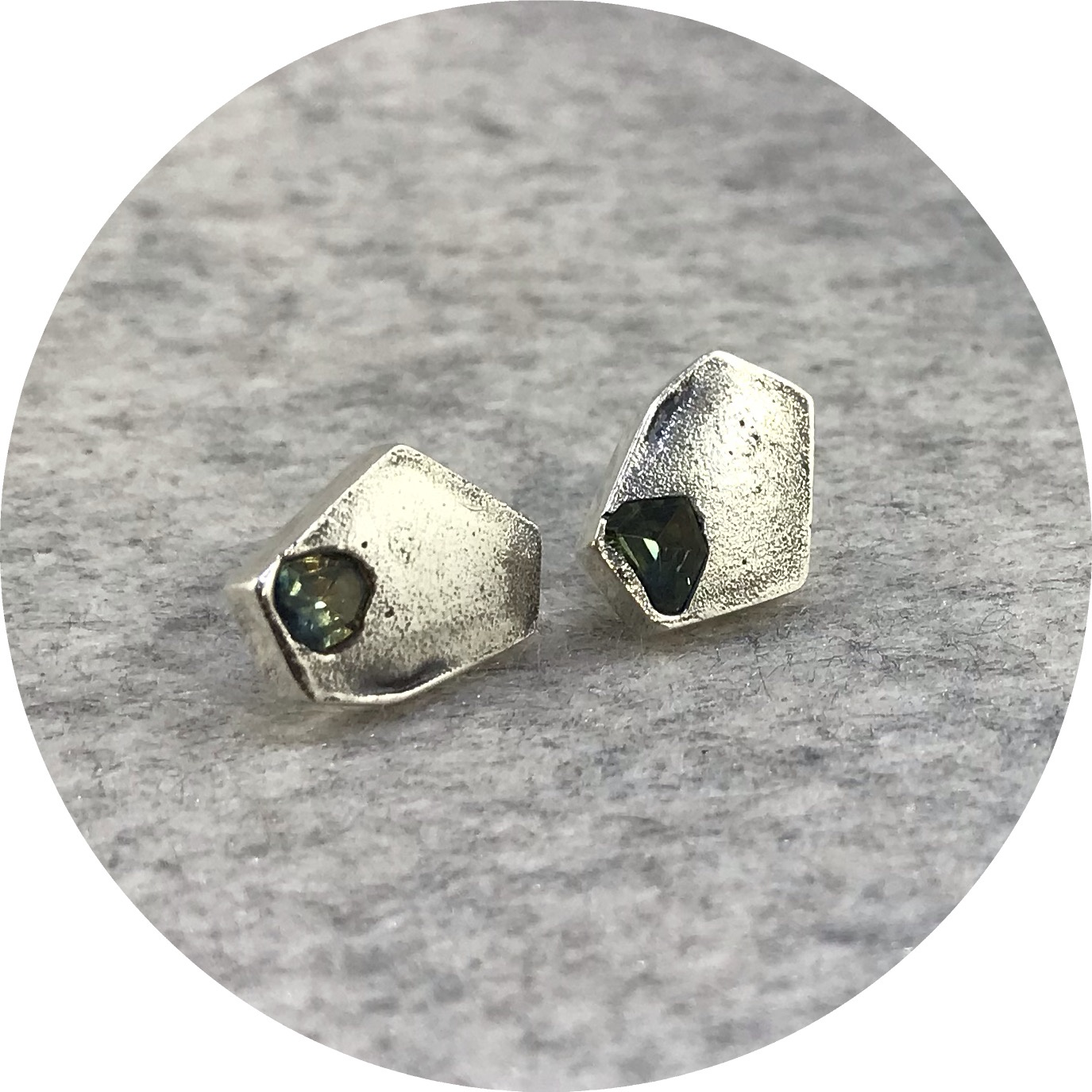 Kirra-Lea Caynes- Stud earrings. Facetted green sapphires in sterling silver.